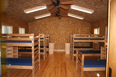 Equal To Four Of The Existing Cabins, The New Lodges Boast Larger Rooms, A  Central Meeting Area, Bathrooms, Fans, Electricity And Lights.